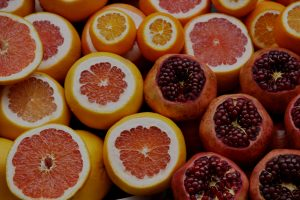 Detailed photo of sliced oranges, blood oranges and pomegranites